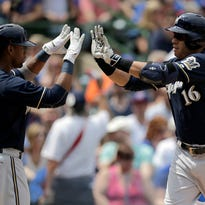 Milwaukee Brewers third baseman Aramis Ramirez (16) celebrates with teammate left fielder Khris Davis (18) after hitting a homerun during the second inning of a baseball game against the Chicago Cubs in Chicago Sunday.