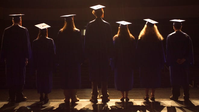 The district's graduation rate has risen for years.