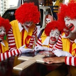 Demonstrators dressed as Ronald McDonald participate in a protest against McDonald's for alleged exploitation of workers on April 15 in Sao Paulo, Brazil.