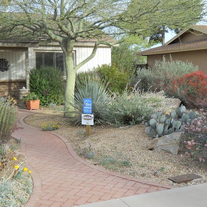 The front-yard makeover included an inviting walkway