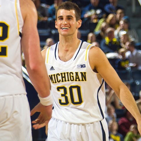 Michigan guard Austin Hatch plays against Coppin State in Ann Arbor on Dec. 22, 2014.