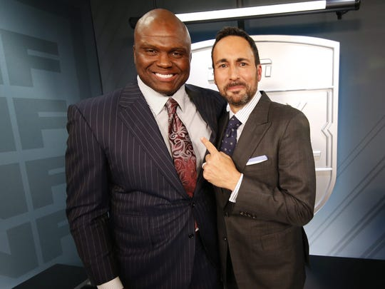 ESPN Monday Night Football hosts Booger McFarland and Joe Tessitore in the broadcast booth before an NFL football game between the New Orleans Saints and the Houston Texans in New Orleans, Monday, Sept. 9, 2019. (AP Photo/Gerald Herbert) ORG XMIT: NYOTK