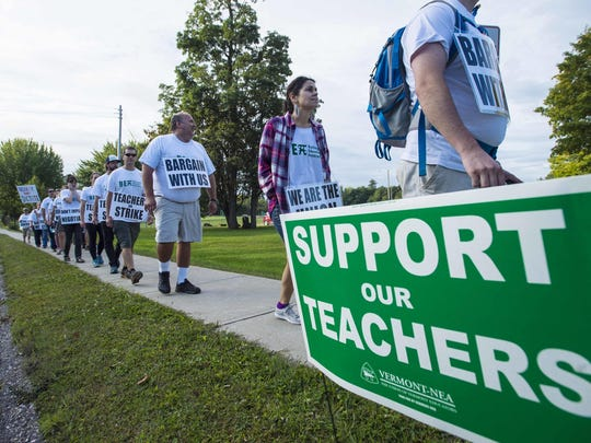 Striking Burlington teachers walk a picket line outside the high school on Thursday, Sept. 14, 2017.