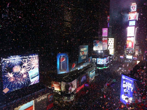 Confetti flies over New York's Times Square 2013 begins.