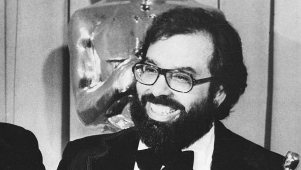 Francis Ford Coppola poses with his Oscar statuettes