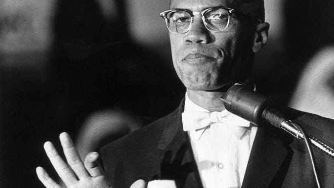 Malcolm X, here circa 1962, at a rally in Washington, D.C.