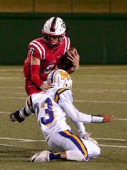Muenster's Parker McGrew (6) avoids a tackle attempt