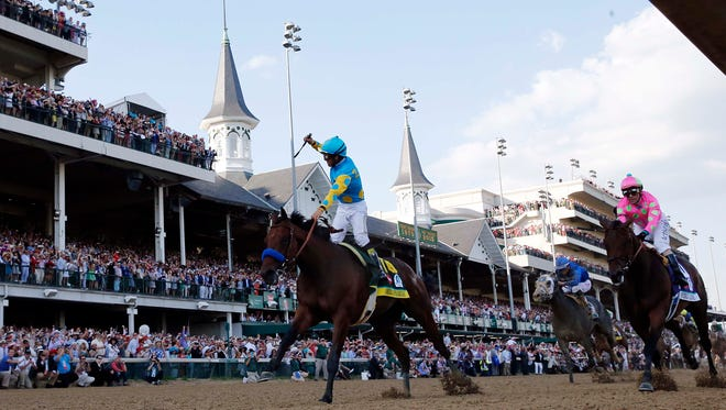 Victor Espinoza celebrates aboard American Pharoah after winning the 141st Kentucky Derby on May 2, 2015, at Churchill Downs in Louisville, Kentucky.