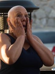 Cecilia Mata, wipes tears from her eyes at Wing Daddy's, Friday March 10, 2017, where she was giving donations that six local motorcycle clubs gathered for her as she battles cancer and looking  for a new place to live after losing her current home.