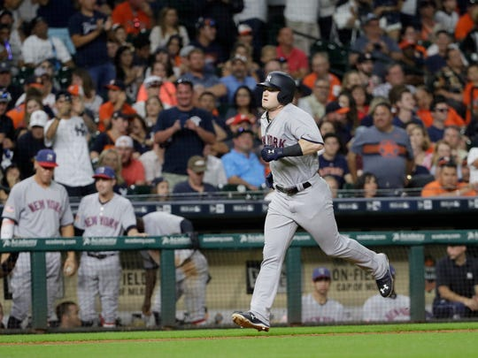New York Yankees' Clint Frazier runs the bases after hitting a home run against the Houston Astros during the seventh inning of a baseball game Saturday, July 1, 2017, in Houston.