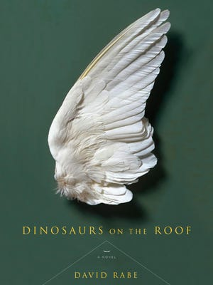 "Cover of ""Dinosaurs on the Roof"" by David Rabe, who  was among the winners of the PEN American Literary Awards."
