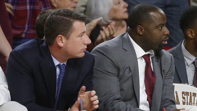 Former Arizona State assistant men's basketball coach Brian Merritt (left) recently had a DUI case against him dismissed in Scottsdale City Court.