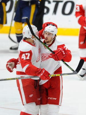 Red Wings defenseman Brendan Smith celebrates with defenseman Alexei Marchenko  after a goal during the first period Saturday in Nashville, Tenn.
