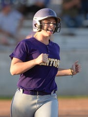 Sarah Koeppen sticks her tongue out after hitting a
