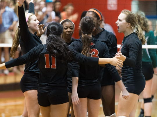 The Leon volleyball team celebrates a point on the way to a 3-1 win over Lincoln in a Region 1-7A semifinal.