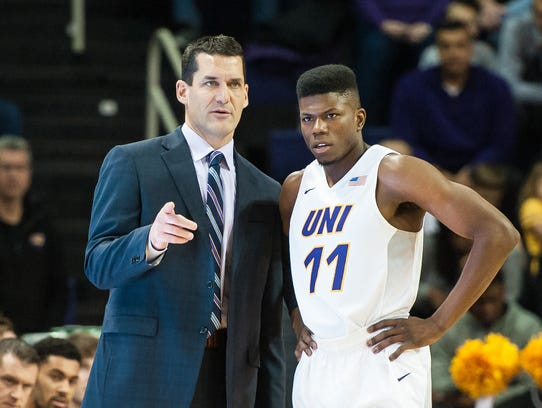 Northern Iowa coach Ben Jacobson talks to guard Wes