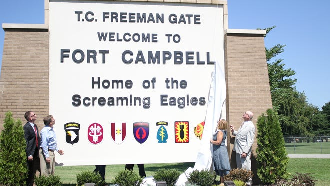 The Freeman family unveils the new T.C. Freeman Gate sign at what was formerly Gate 4 at Fort Campbell during a ceremony Tuesday.