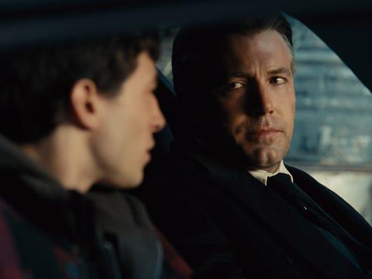 Barry Allen (Ezra Miller, left) is recruited for the