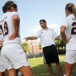 Dustin Smith works with members of the Florida Tech women's soccer team.