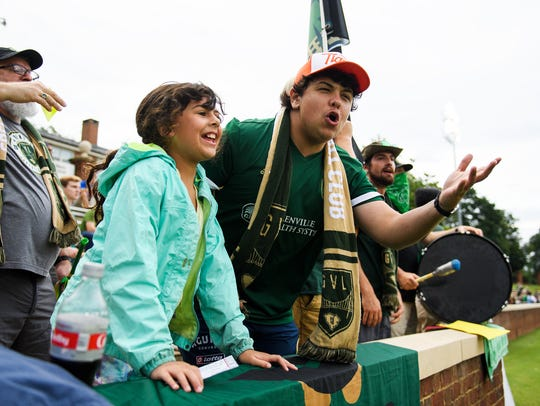 "Alex Brotherton, 20, and his sister Sofia, 9, during a Greenville FC game against the New Orleans Jesters on Wednesday, June 27, 2018. When Alex Brotherton found out that Greenville FC was launching a team this year, he ""bought all in,"" he said."