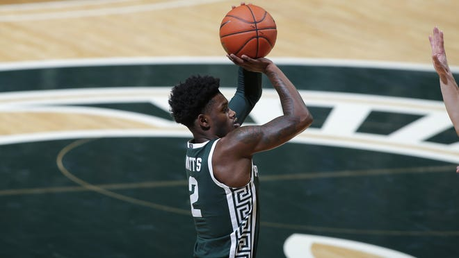 Michigan State's Rocket Watts shoots against Wisconsin during the first half of an NCAA college basketball game, Friday, Dec. 25, 2020, in East Lansing, Mich. Wisconsin won 85-76.