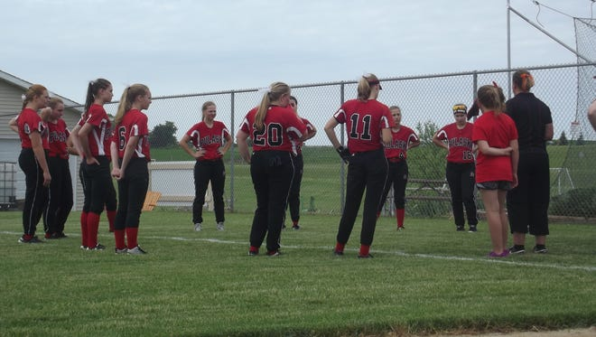 Pulaski coach Billi Jo Vertz talks to her team following a 10-3 loss to Stevens Point in a WIAA Division 1 state semifinal game that was finished on Saturday after play was suspended Friday night at Goodman Diamond in Madison due to inclement weather.