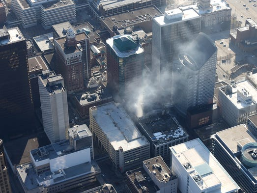 Smoke continues to billow from an overnight fire at the former Younkers building in downtown Des Moines early Saturday morning on March 29, 2014.