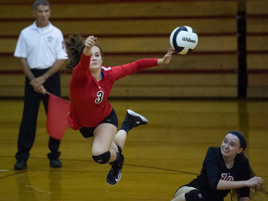 Harrison's libero dives to save the ball as Harrison High School faces Jasper High School in the second game of the 2017 IHSAA Volleyball Sectional tournament at Harrison High School in Evansville, Ind., on Friday, Oct. 13, 2017. Jasper won in three straight sets.