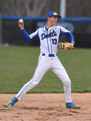 Zanesville shortstop Brandon Pritchard throws the ball to first base during Friday's game with Coshocton. Zanesville rallied for a 5-3 win in ECOL play.