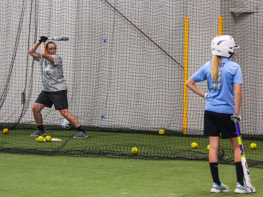 The Cedar National U-12 softball team practices on