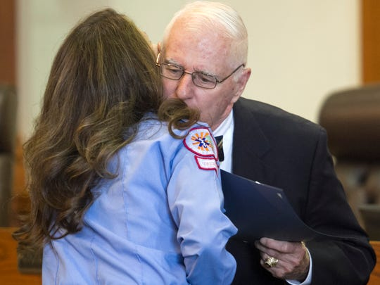 Henry Morgan hugs Michelle Desjardin during the Phoenix Awards on Friday, December 12, 2014. Desjardin was one of the responders that saved Morgan's life. This was Desjardin's fifth Phoenix Award.