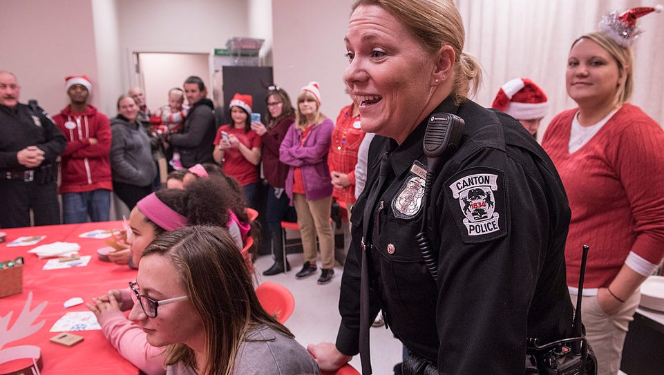 Officer Patty Esselink greets the kids and explains