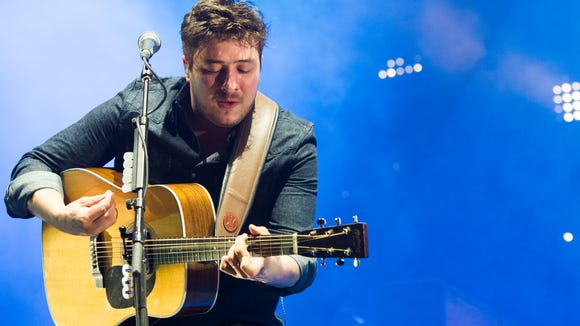 Mumford & Sons performs on Wednesday, Aug. 28, 2013 at the West Side Tennis Club in New York.