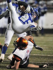 Calvert's Zach Conn gets upended by Lucas' Mason Galco Friday night at Bellevue High School.