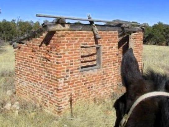 Spanky investigates a brick structure that endured