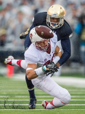 Stanford wide receiver Devon Cajuste misses a catch as Notre Dame safety Elijah Shumate in 2014.
