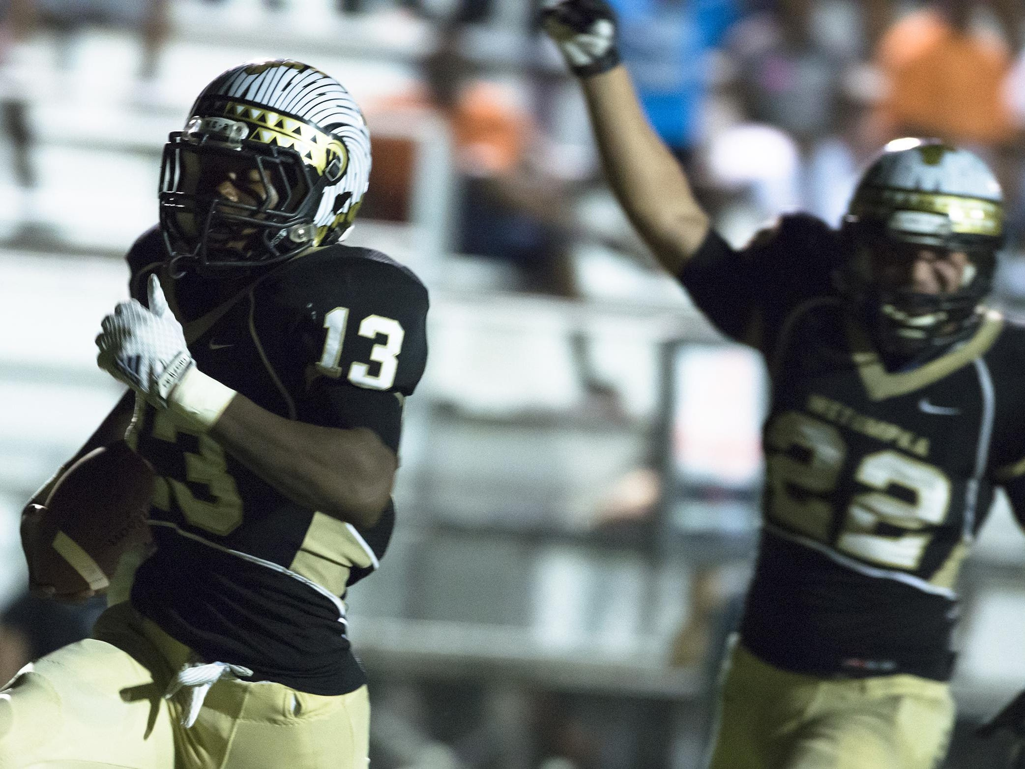 PHOTOS BY ALBERT CESARE/ADVERTISERWetumpka's Khaliq Jones scores a touchdown and was able to add a two-point conversion to tie the game at 36 in the fourth quarter against Huffman. Wetumpka's Khaliq Jones (13) runs for a touchdown to tie the game after a two point conversion at 36-36 in the 4th quarter during the game between Wetumpka and Huffman in Wetumpka, Ala., on Friday, Aug. 29, 2014.