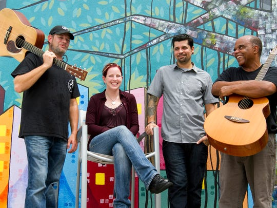 Lyricists Mellissa Shiflett and Will Soto, center, stand alongside Hope by Song singer/songwriters Matt Hannam, left, and Bill Metts at Hotel Indigo in Fort Myers.
