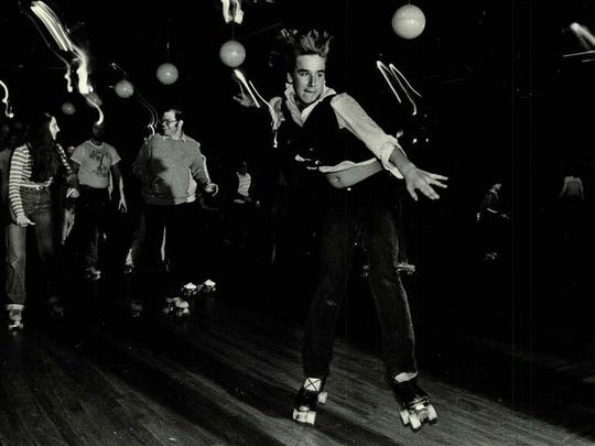 Dave Maroulis, a rink guard at United Skates of America, demonstrates his skills in this 1980 file photo.