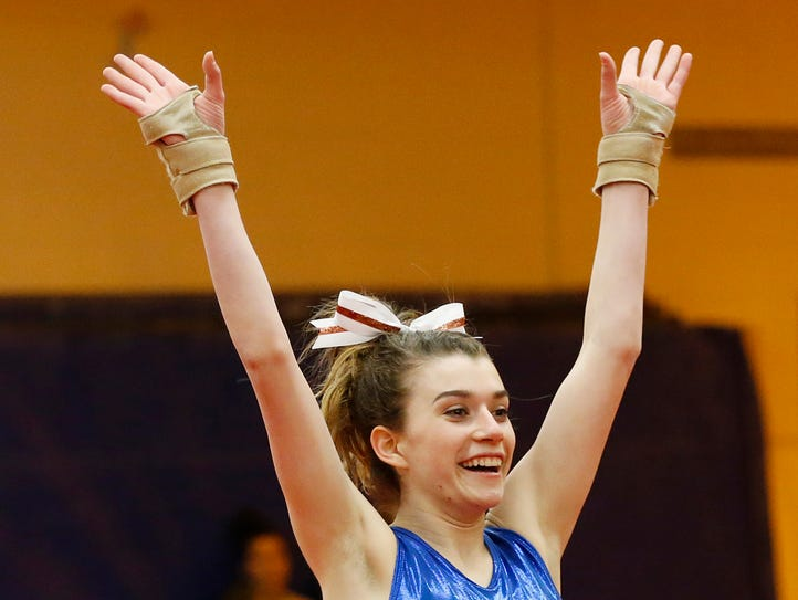Emily Laux of Harrison completes her routine in the