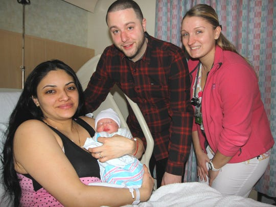 Gianna Isabella D'Onfrio, was the first 2016 baby born at Trinitas Regional Medical Center in Elizabeth She is pictured with her mom, Giovanna Rosero, father Elbio D'Onfrio and nurse Julia Wesolowski.