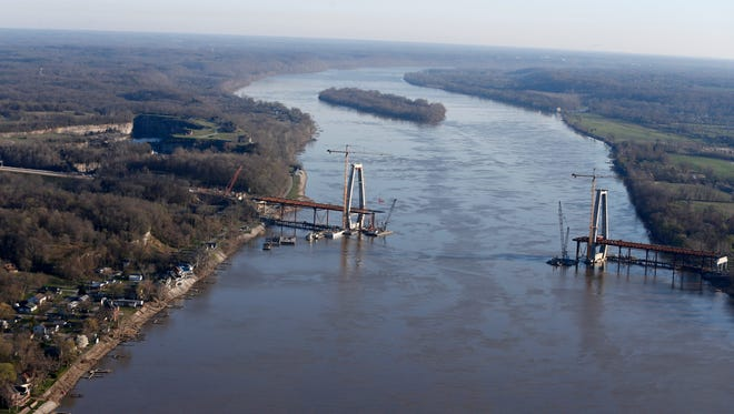Utica, Ind., can be seen to the left of the new bridge under construction.