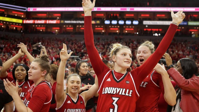 Louisville players celebrated at center court after defeating second ranked Notre Dame. Jan. 11, 2018.