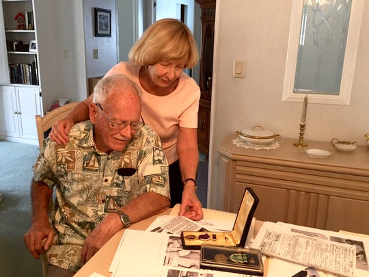 Ann and William Blaisdell looking back at his artifacts from the Korean War.
