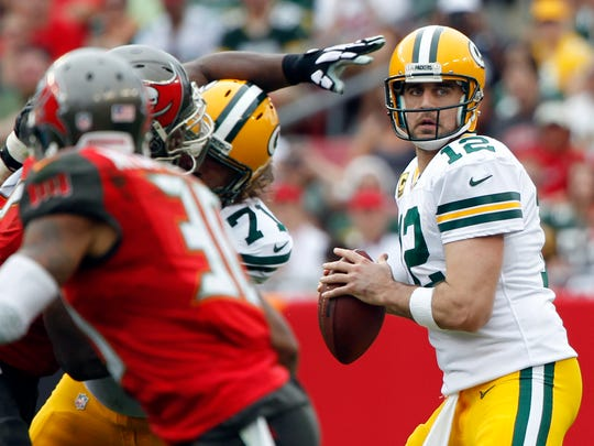 Green Bay Packers quarterback Aaron Rodgers (12) throws the ball against the Tampa Bay Buccaneers during the first half at Raymond James Stadium.