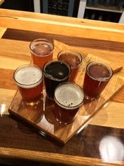 Flights of beer are served on keystone-shaped trays