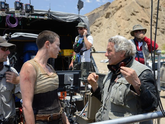 "Charlize Theron (left) and George Miller on the set of ""Mad Max: Fury Road."""