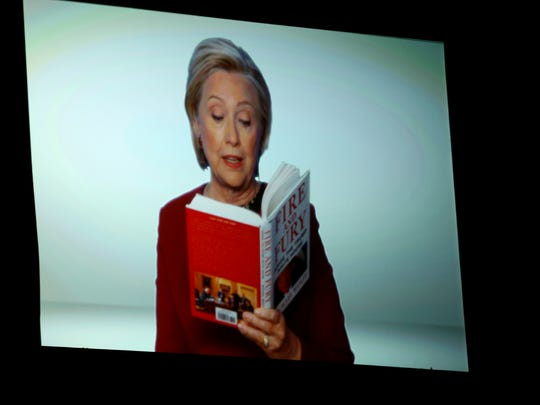 Hillary Clinton appears on screen reading an excerpt from the book 'Fire and Fury' during a skit at the 60th annual Grammy Awards.