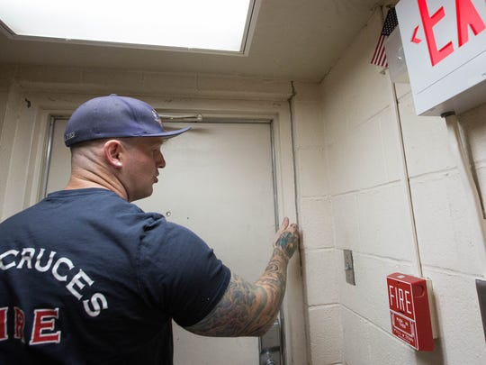 Lt. Gage Lawhorn shows where part of the door frame was separating from the walls of Fire Station 3, Friday July 20, 2018. One of the for GO bonds would be used to build a new fire station to replace station 3 on Valley.