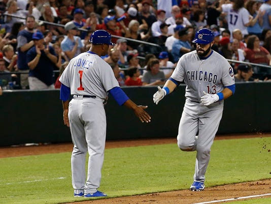 Chicago Cubs' Alex Avila (13) celebrates his home run against the Arizona Diamondbacks with third base coach Gary Jones (1) during the sixth inning of a baseball game Friday, Aug 11, 2017, in Phoenix. (AP Photo/Ross D. Franklin)